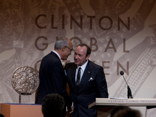 September 23, 2010  Actor Kevin Spacey welcomes Dr. Jean Pape to the podium to accept the Clinton Global Citizen Award.
