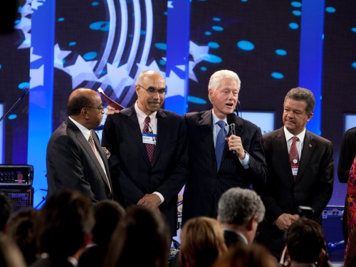 Former President Bill Clinton stands with Global Citizen Award Honorees. On the left, Dr. Mohamed Ibrahim and Dr. Jean Pape. On the right, President of the Dominican Republic Leonel Fernandez