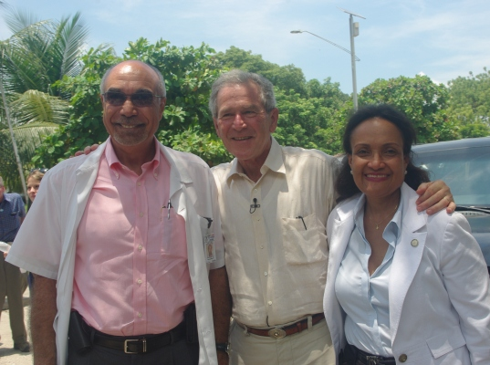 Former President George W. Bush with Dr. Jean Pape and Dr. Marie Marcelle Deschamps. Mr. Bush visited GHESKIO in early August on behalf of the Clinton Bush Haiti Fund.