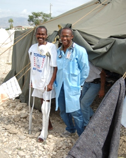 Dr. Macarthur Charles with a patient being treated for tuberculosis in GHESKIO's field hospital