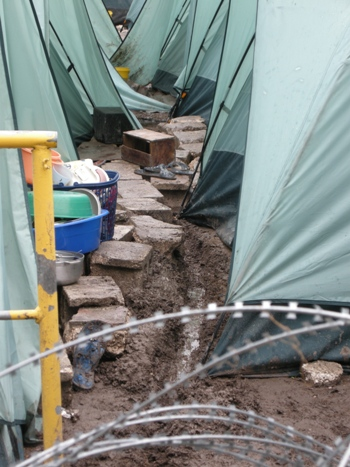 Rubble is used to make pathways in camp as the rains continue.